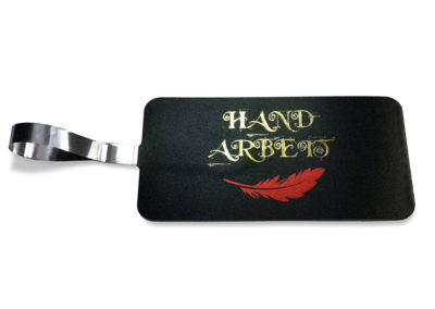 Artistic jewellery tag, golden letter on black, red feather