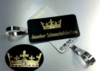 Jewellery tags with golden crown and imitations of jewels